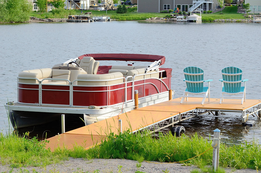 Red Pontoon Boat Tied to a Dock With Two