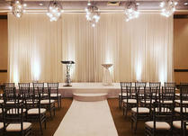 De Lux Wedding Ceremony Package_stage_drapes_runner_uplights_halfmoon step_ Yellow Shoes E