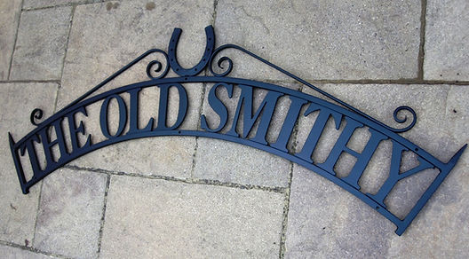 Forged blacksmith wall sign
