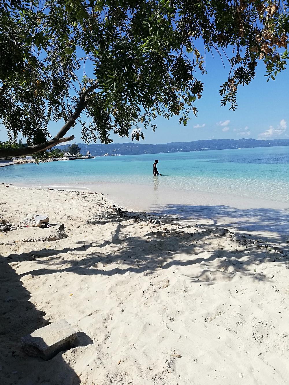A section of Dead end beach with shade and view towards Montego Bay City center