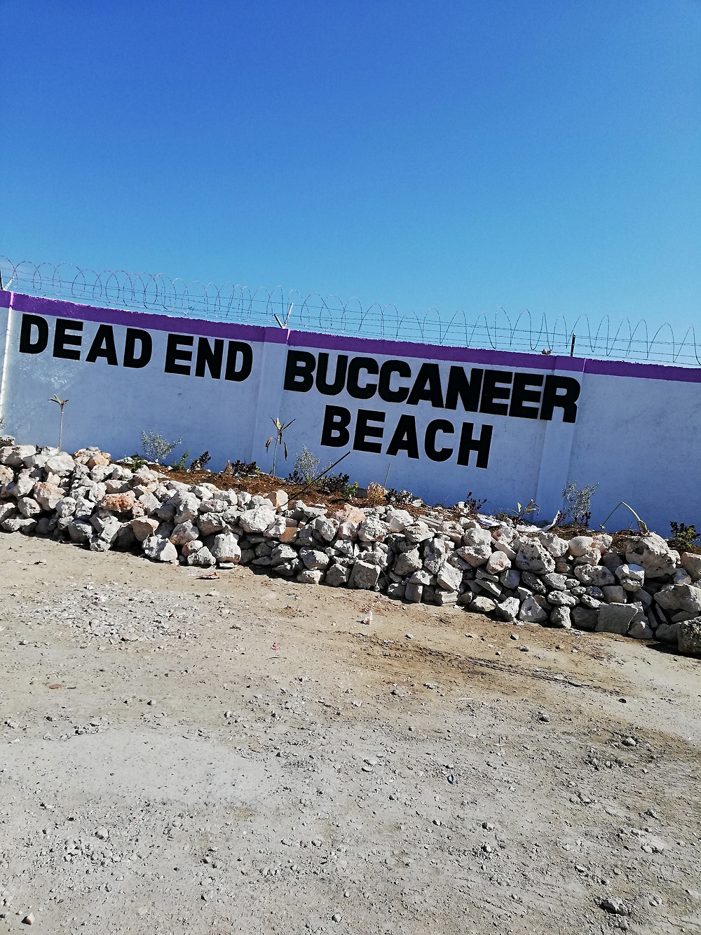The beach sign at the perimeter of the Airport
