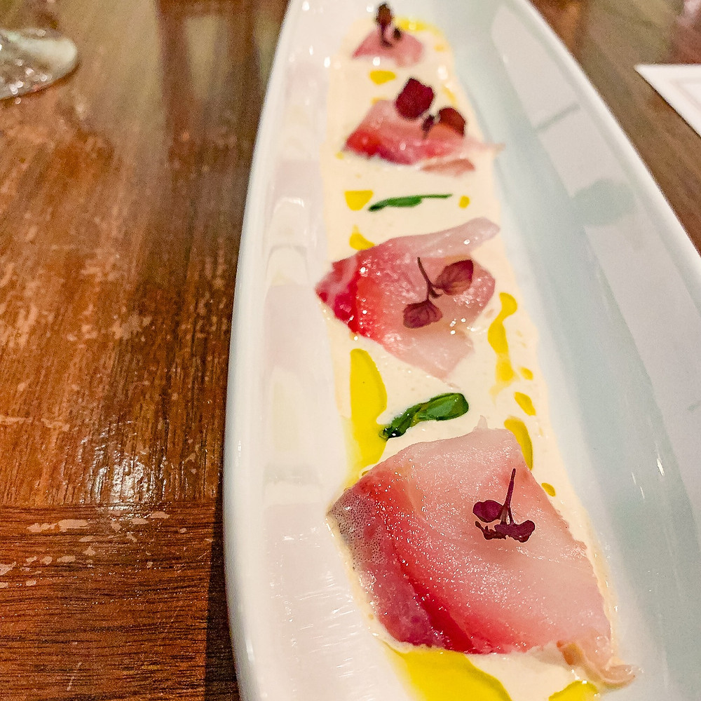 bass crudo with lobster and ginger sauce