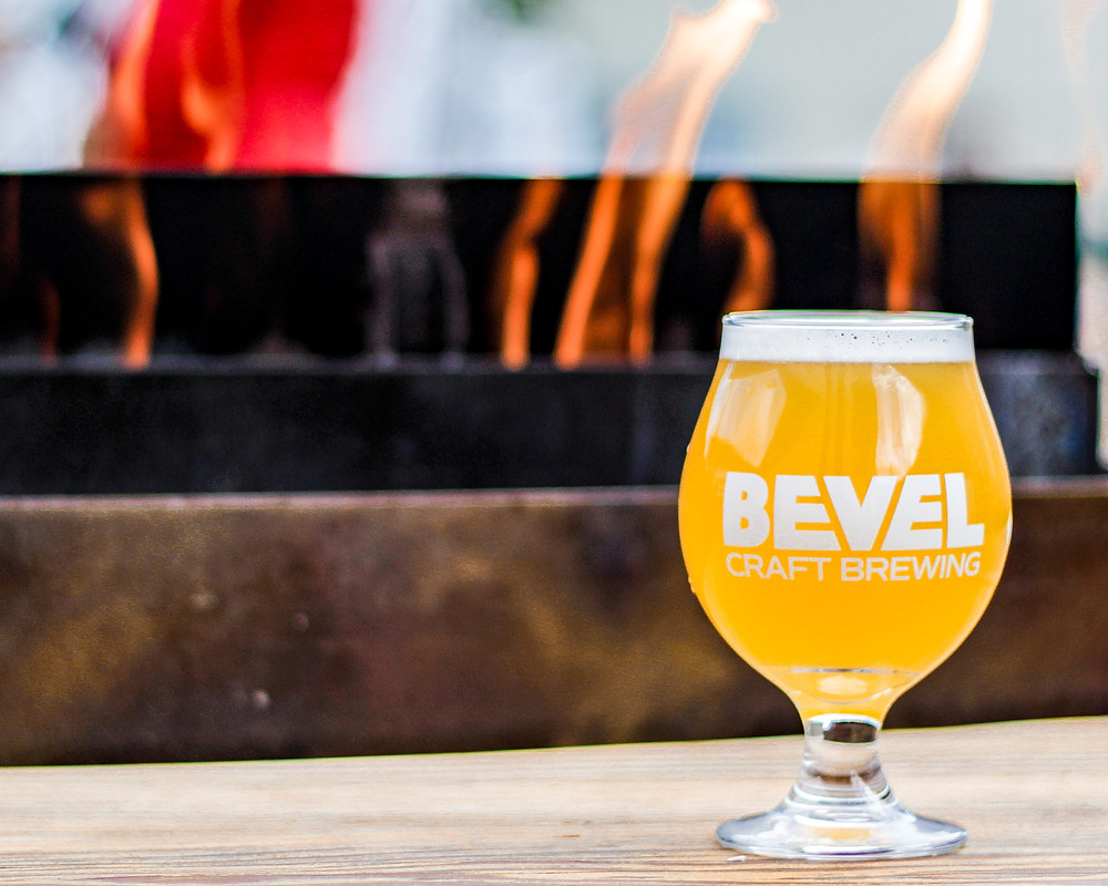 A pint of Bevel Beer sky-styler farmhouse style IPA at the 9th street village food cart lot in Bend, Oregon