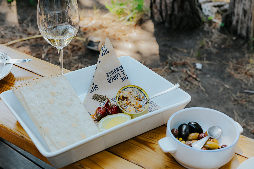 Abacela winery albariño served with a spanish canned fish and rosemary crackers with lemon