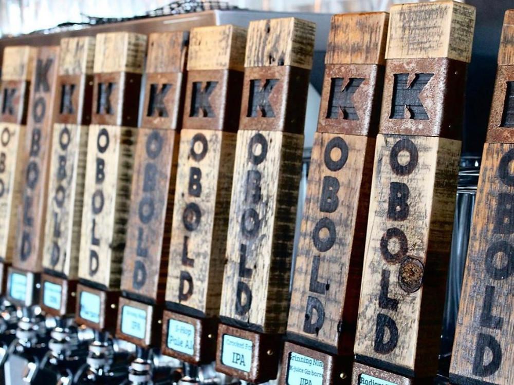 Tap handles for several Kobold Brewing beers in Redmond, Oregon