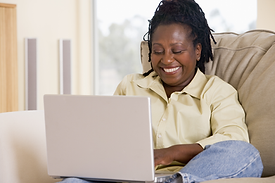 Black woman on laptop.png