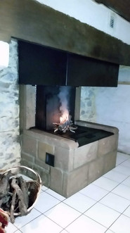 Foyer Polyflam dans ancienne cheminée rénovée