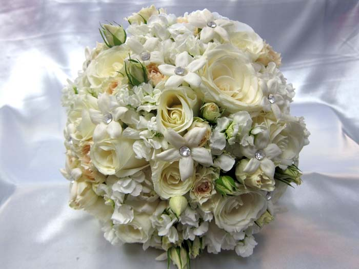 336 KC Creations Weddings and Events stephanotis white roses spray roses bouquet