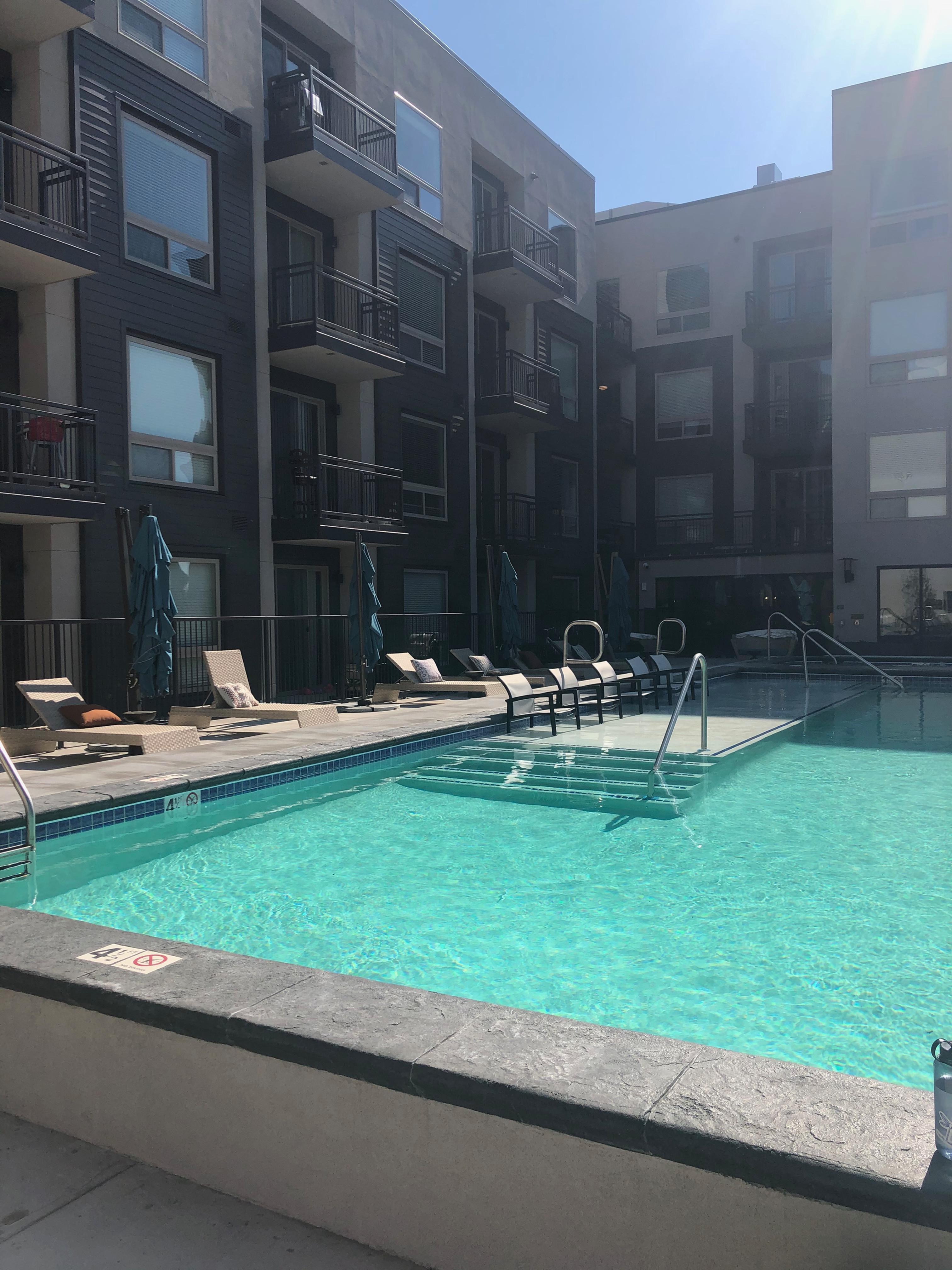 Yoga at the Pool Riverwalk Apartments