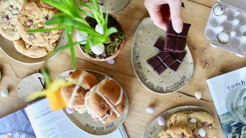 Easter treat plates with hot cross buns, cookies and chocolate eggs