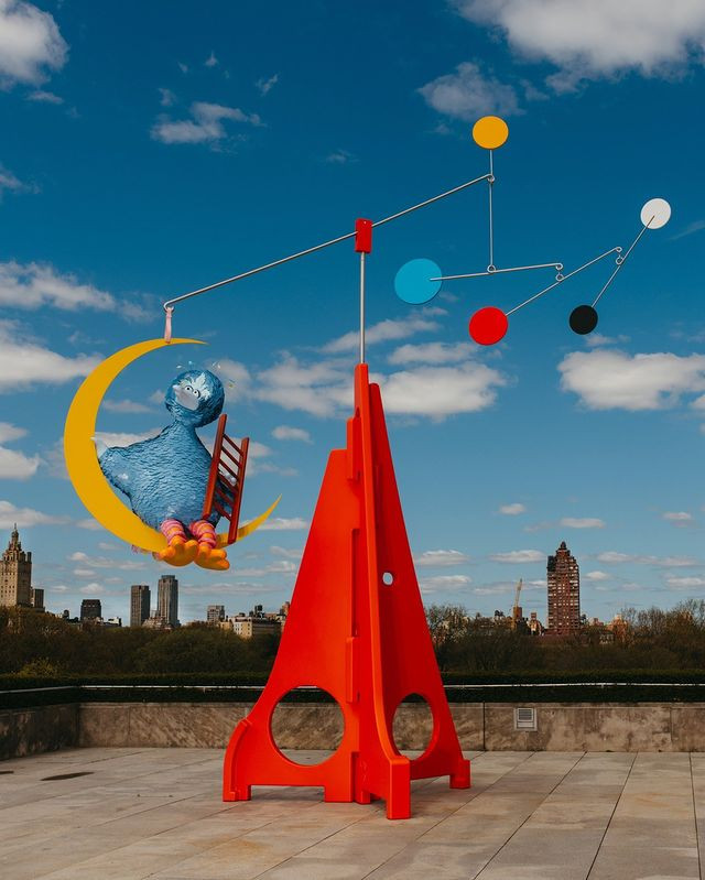 A melancholy Big Bird is now swinging from a mobile on the roof of the Metropolitan Museum.