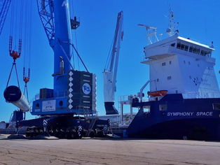 Symphony Space loading windmill equipment in Spain for the Med