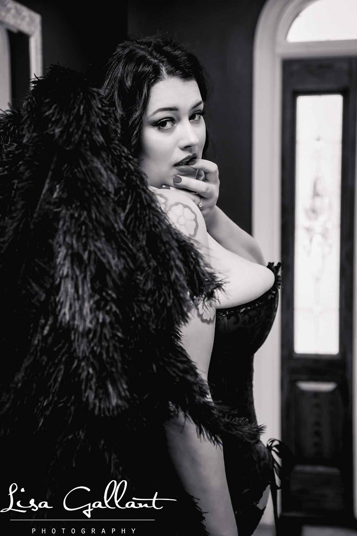 black and white image of woman in black angel wings, Charleston boudoir