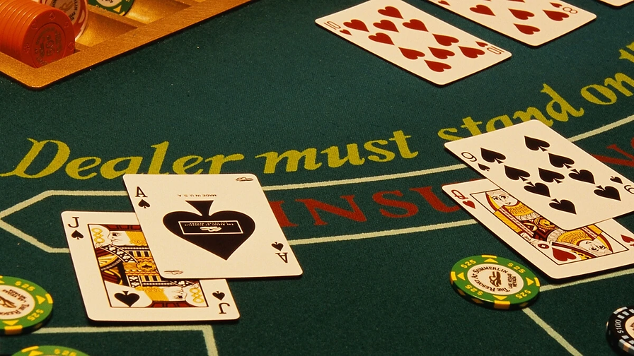 Two-Hands-on-a-Blackjack-Table-at-a-Casi