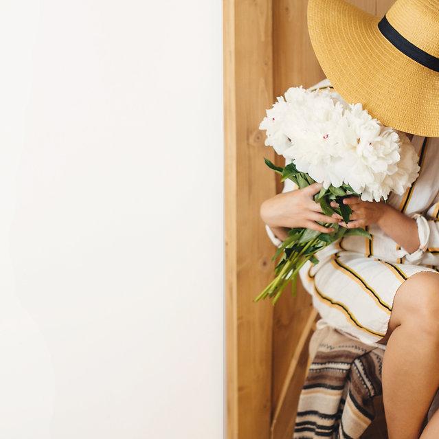 portrait-of-boho-woman-in-hat-holding-white-peony--RZJ6X2D_edited.jpg