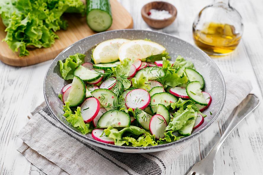 Vegetarian vegetable salad of radish, cu