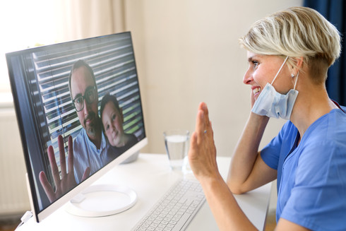 woman-doctor-having-video-call-with-pati