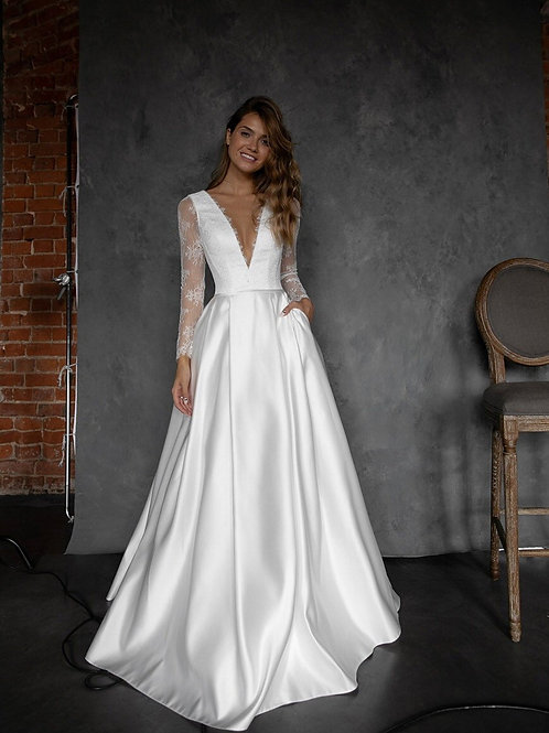 Satin wedding dress Faen by Olivia Bottega. Long sleeve wedding dress. Pockets on skirt. French Lace long sleeves. deep neckl