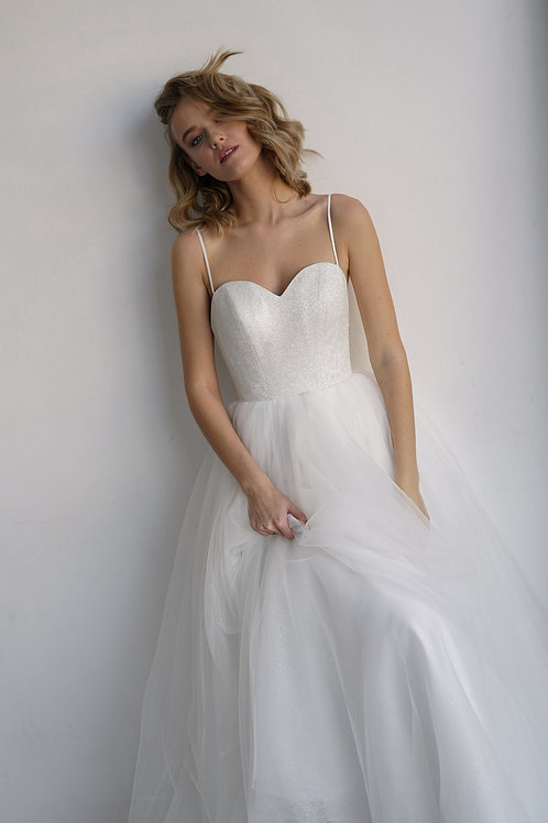 Wedding dress KLOUZI by Olivia Bottega with glistening long and midi skirt. Open Ball delicate wedding dress without sleeves.