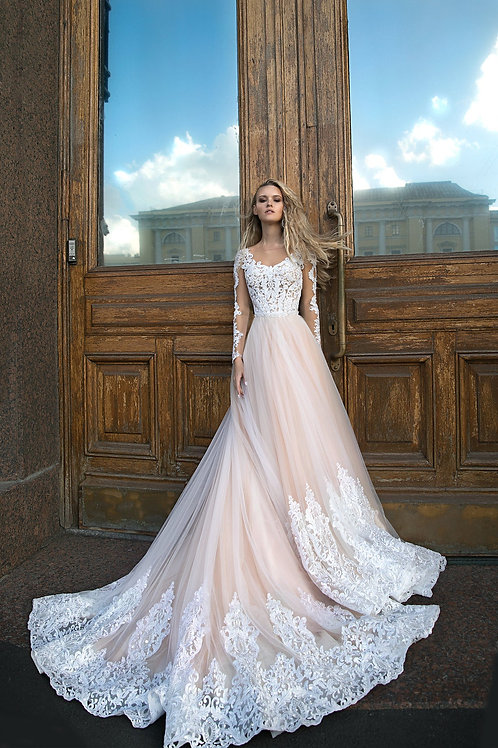A Silhouette wedding dress Greyst by Olivia Bottega, long sleeves wedding dress, lace on the bottom of skirt wedding dress.