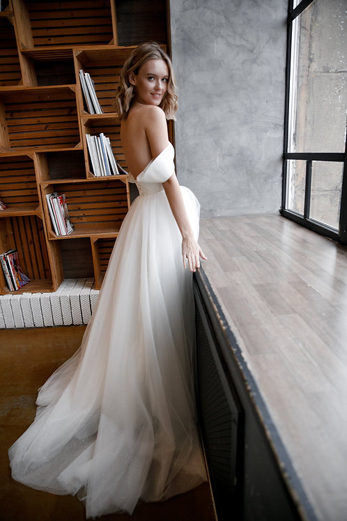Wedding dress KLOUZI 2 by Olivia Bottega with glistening long skirt. Open Ball delicate wedding dress without sleeves.