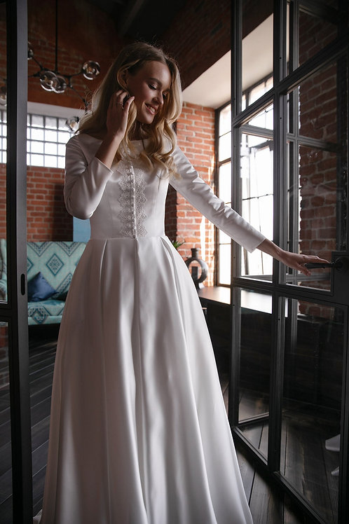 Minimalistic open satin wedding dress Klio with buttons on front. A silhouette wedding dress. Long a sleeves. Back with zippe
