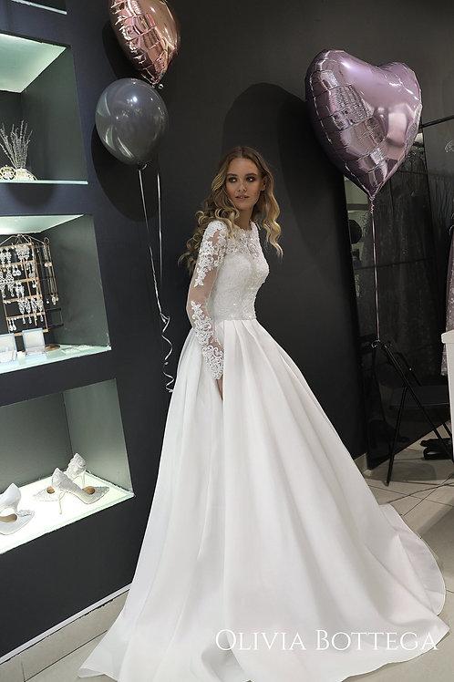 Mikado wedding dress Tviko by Olivia Bottega. Long sleeve wedding dress. Pockets on skirt. Lace long sleeves.