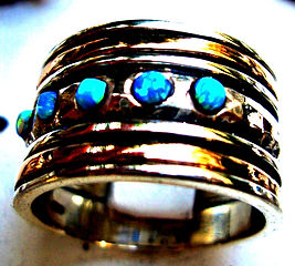israeli-opal-spin-ring-silver-and-gold-j
