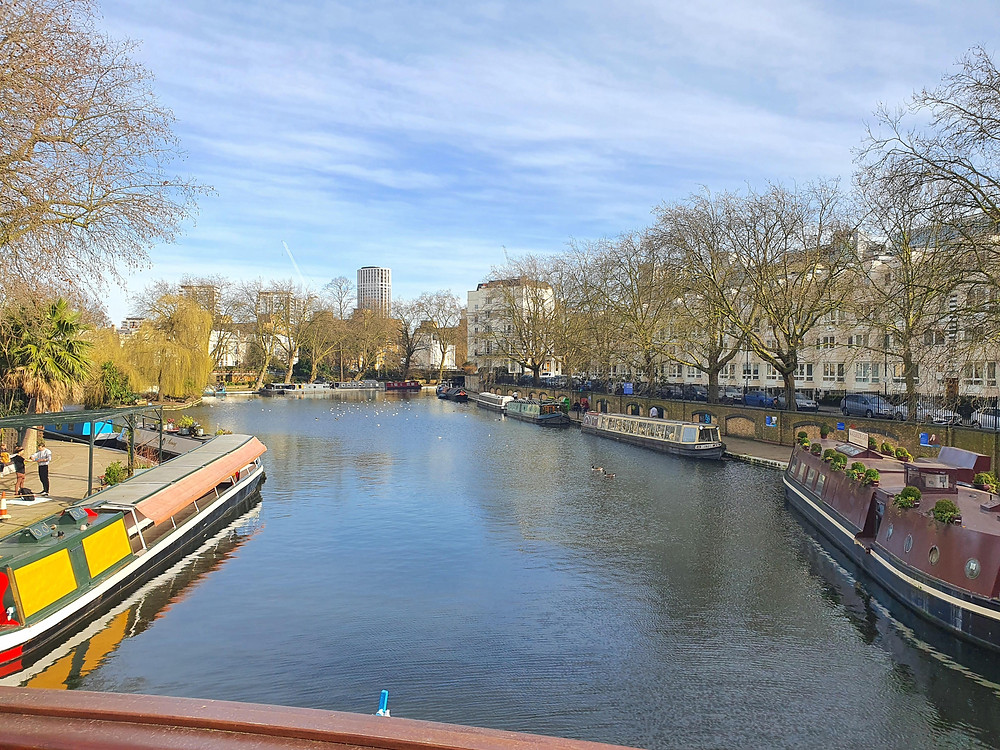 Little Venice in London is in the main picture with canal boats on either side.