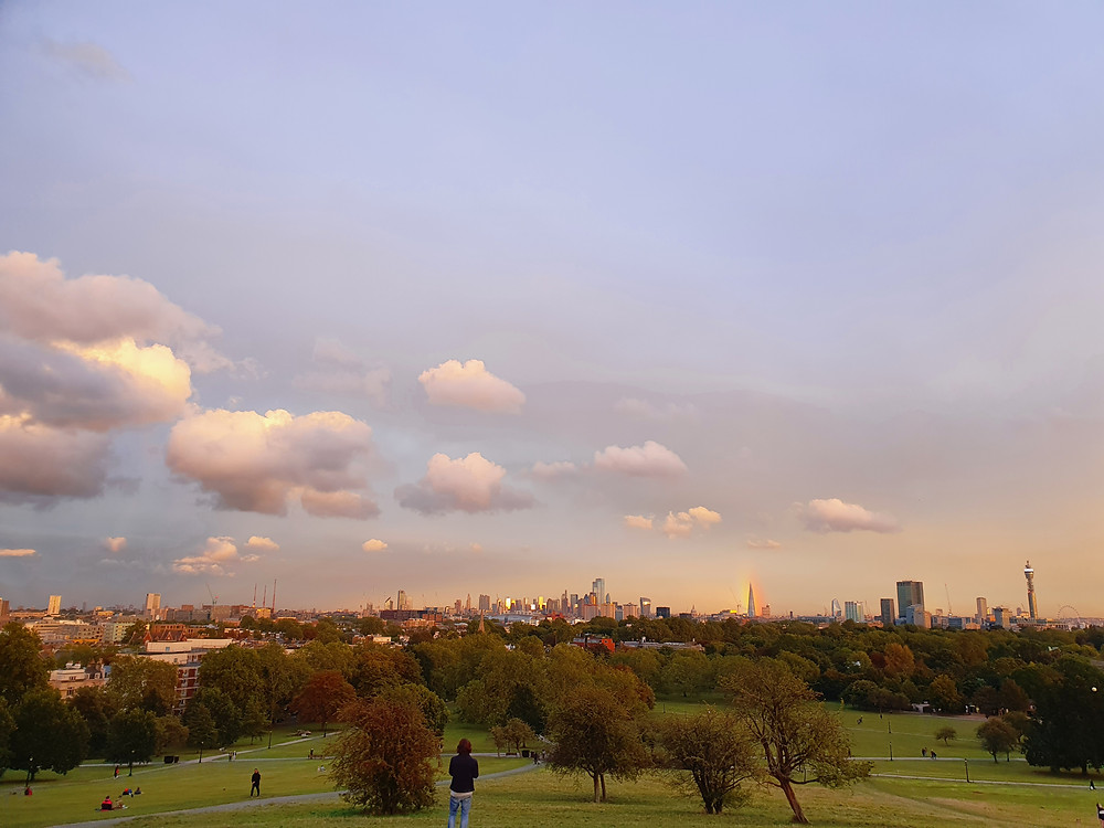 Atop of Primrose Hill, taking in London's beautiful scenery.