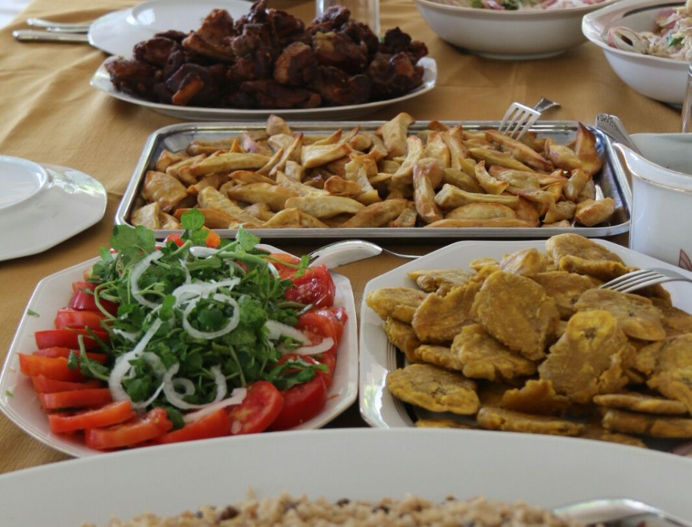 Haitian feast. Fried plantains on the right; griyo, back left.