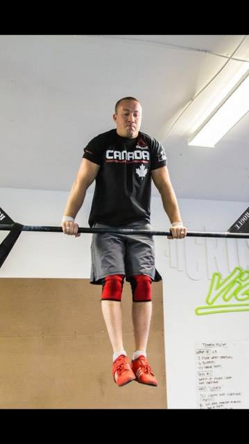 Coach Phil doing some bar muscle ups