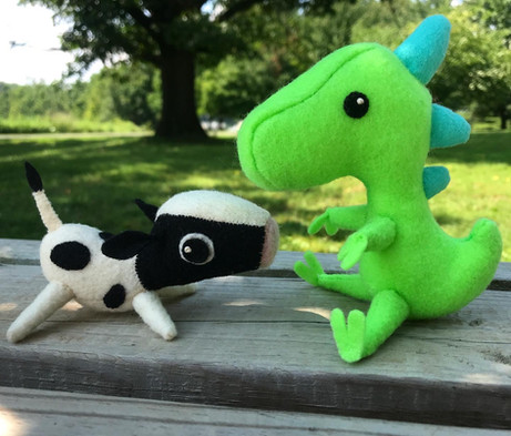 Barnaby the Cow and Cam the Dino