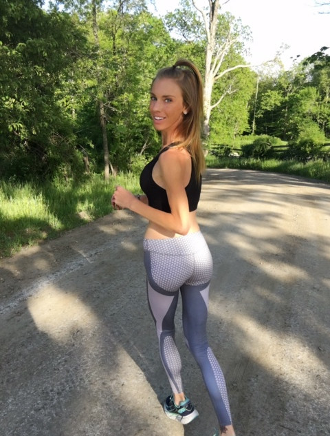 Purely Palmer running in beautiful tights and top in the middle of the road wearing jewery accessories including bracelets and necklaces.