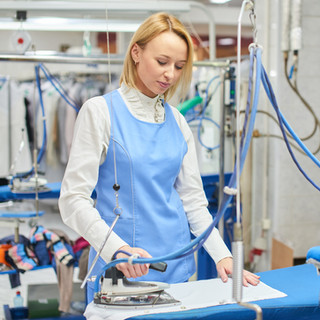 Worker Laundry ironed clothes iron dry.j
