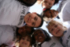 Stock LU Kids in Huddle.JPG