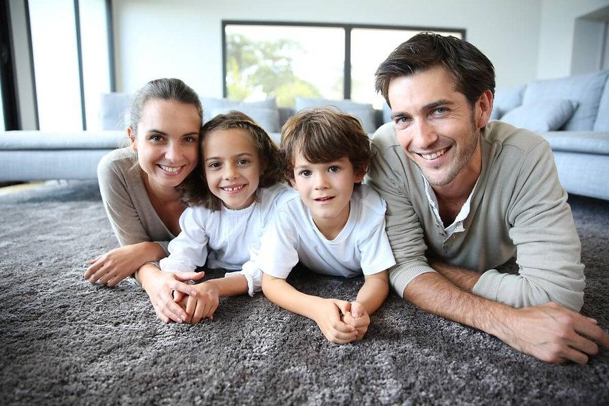 family-relaxing-on-carpet.jpeg