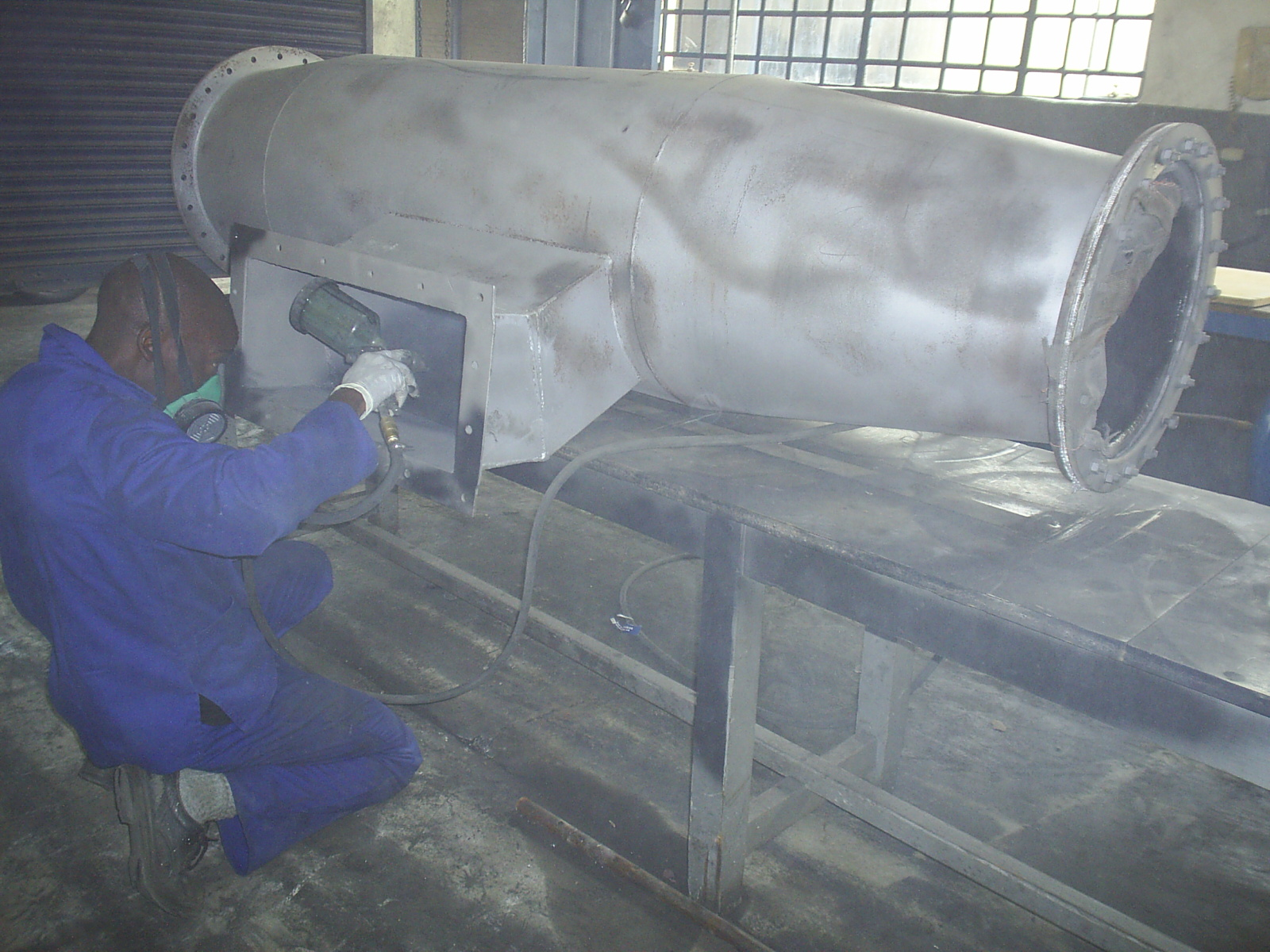 Coating a large pipe