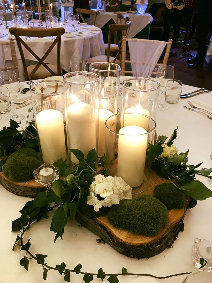 Wooden log slices and candles