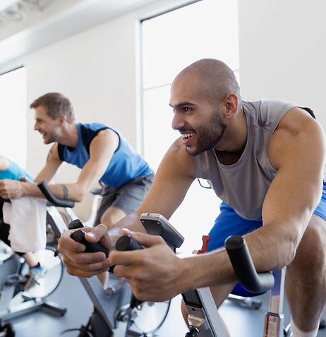 Spin class with fitness instructor