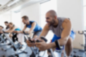 men-in-cycling-class-at-gym