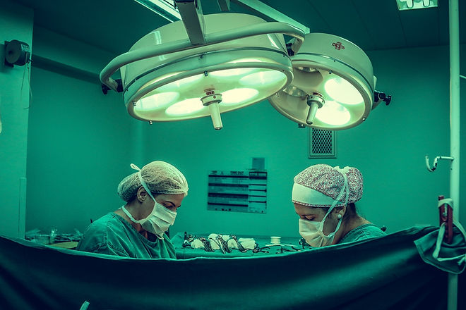 two-person-doing-surgery-inside-room-125