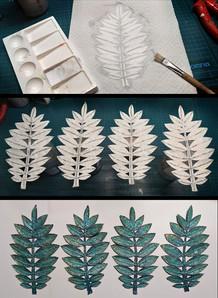 Überleimen der Grundformen mit Küchenpapier, erneutes Konturschneiden, Bemalen - fertig!