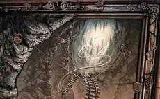 """Aufsetzen von kleinen Seilwinden, die die gemalte Hängebrücke """"halten"""""""