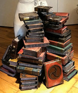 Gluing the individual books together to form a stack of books according to the original illustration