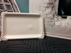 The basic shape of the baseboards is cut from the edges of paper plates and glued to the side walls