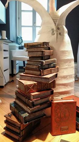Building numerous books (Styrodur, cardboard, paper)