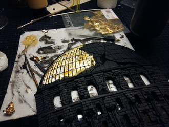 Attaching gold leaf on the sunlit roof areas