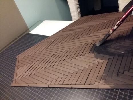 adding black primer to the floor