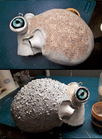 Head texture: Gluing of sand and stones for an uneven surface structure